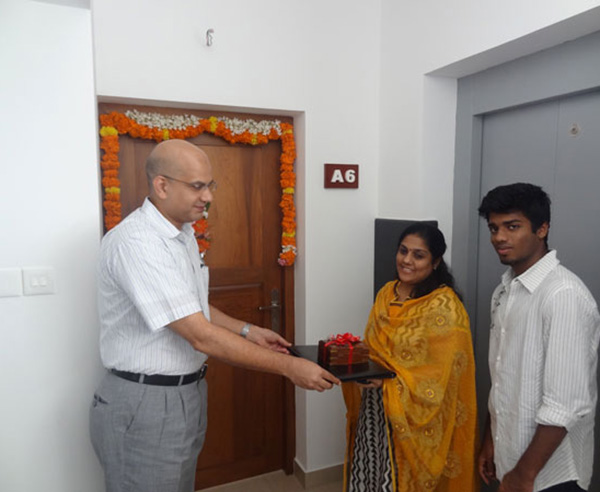 Keys being handed over to Ms. Sheeja Ajai of apartment A 6