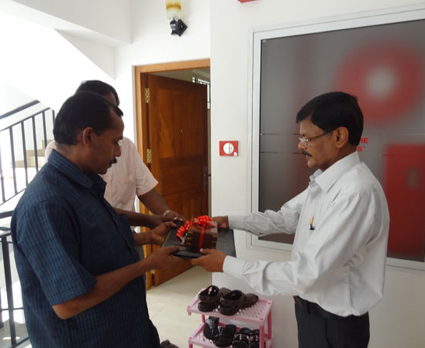 Keys being handed over by GM - Projects Mr. Sasidharan to Mr. John on behalf of Mr. Jose Philip of apartment C 1