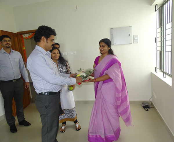 Our Administration Manager greeting Ms. Pushpalatha Rajan of apartment D 13 in Crescent Aster during handing over ceremony.