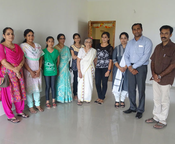 Our GM - Sales & Marketing Savin Monu and Relationship Officer Padmaja Rao with Ms. Kavya  & family of apartment D 12 in Crescent Aster after handing over