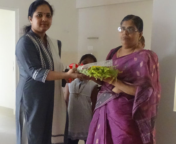 Our Relationship Officer greeting Ms. Sharada of apartment A 3 in Crescent Aster during handing over ceremony.