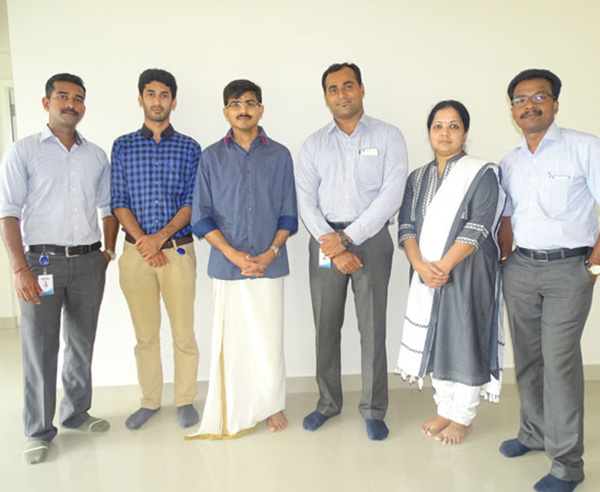 Our team with Mr. Balachandran of apartment D 5 in Crescent Aster after handing over