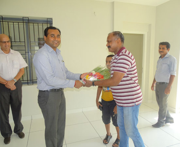Our General Manager - Sales & Marketing greeting Mr.Rajesh T  Krishnan of apartment B 8 Crescent Aster during handing over ceremony.