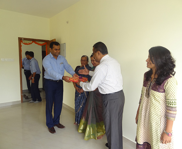 Our G M Sales & Marketing greeting Mr.Krishnan Kutty Nair of apartment D 6,Crescent Iris during handing over ceremony.