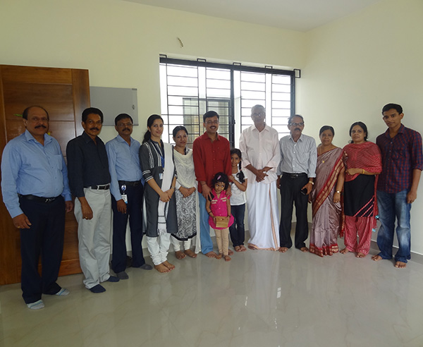 Dr.Binish Sreekumar & family, of apartment F 8 in Crescent Iris during handing over ceremony.
