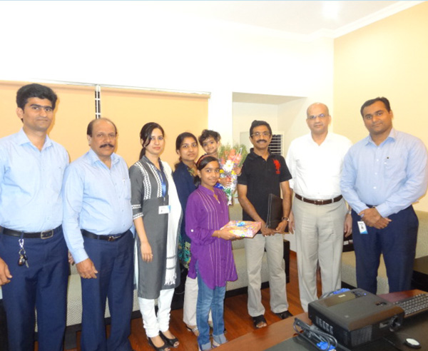 Mr.Anoop Kumar & family,of apartment D 8 in Crescent Iris during handing over ceremony.