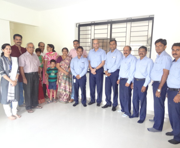 Lt.Col.Arun Menon & family, of apartment B 1 in Crescent Iris during handing over ceremony.