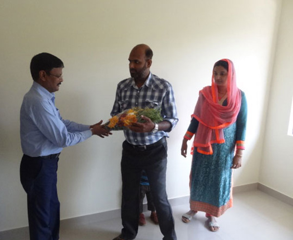Our G M Projects greeting Mr.Jamaludheen of apartment D 4,Crescent Iris during handing over ceremony.