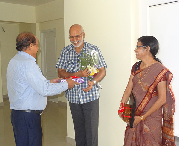 Our G M Administration greeting  Mr.Narayanan of apartment A 3,Crescent Iris during handing over ceremony.