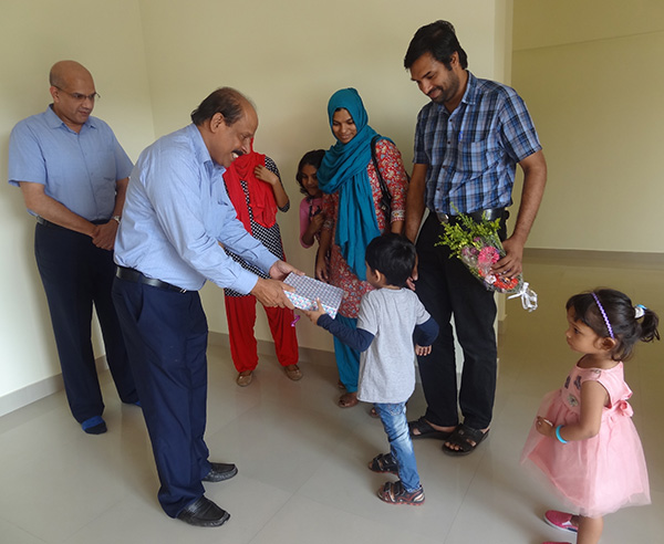 Our G M Administration greeting Dr.Ahammed Naseem of apartment A 4, Crescent Iris during handing over ceremony.