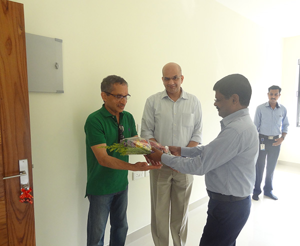 Our G M Projects greeting Mr.Nissar of apartment D 2, Crescent Iris during handing over ceremony.