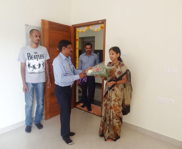 Our G M Projects greeting Ms.Vinaya of apartment B 3, Crescent Iris during handing over ceremony.