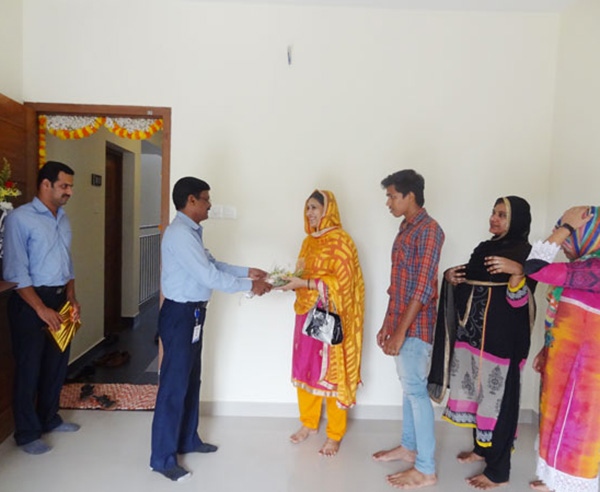 Our G M Projects greeting Ms.Shareena of apartment A 2, Crescent Iris during handing over ceremony.