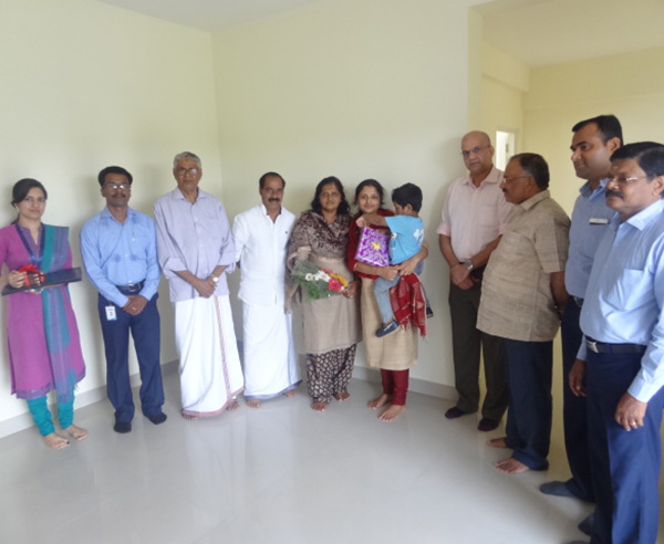 Mr.Kurian Abraham & family, of apartment A 8 in Crescent Iris during handing over ceremony.