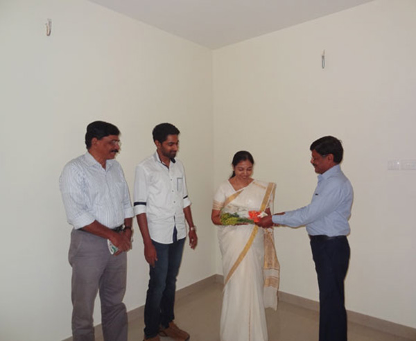 Our G M Projects greeting Ms.Preethy of apartment C 3,Crescent Iris during handing over ceremony.