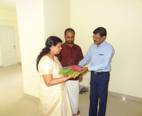 Our G M Projects greeting Ms.Remani of apartment C 6,Crescent Iris during handing over ceremony.