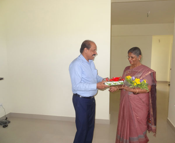 Our G M Administration greeting Ms.Prema Gangadhar of apartment A 5, Crescent Iris during handing over ceremony.