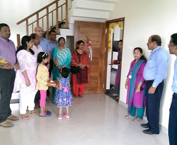 Dr.Krishnaprasad & family, of apartment E 8 in Crescent Iris during handing over ceremony.
