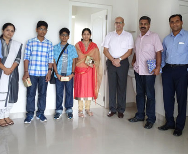 Our team with Mr. Sabiraj Gangadharan of apartment C 7 in Crescent Aster after handing over