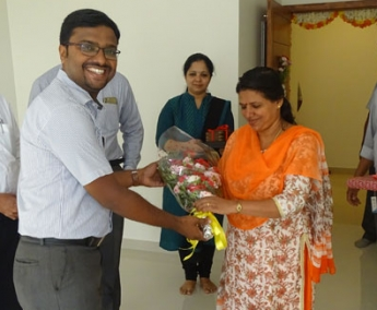Our Project Engineer - Jijo John greeting Ms. Ammu Narayanan of apartment B 4 Crescent tulip during handing over ceremony.