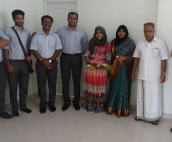 Our team with Ms. Asma V P and family of apartment C 5 in Crescent Tulip after handing over