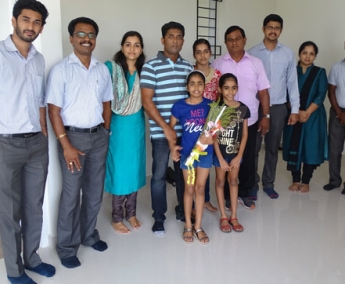 Our team with Mr. Prashanth and family of apartment B 6 in Crescent Tulip after handing over