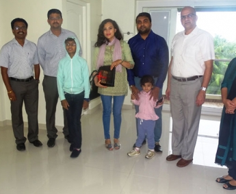 Our team with Mr. Mubash and family of apartment A 8 in Crescent Tulip after handing over