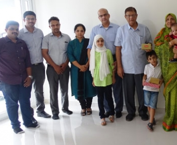 Our team with Ms. Naseem and family of apartment A 7 in Crescent Tulip after handing over