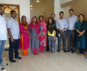 Our team with Dr. Faseela K M and family of apartment C 7 in Crescent Tulip after handing over