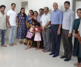 Our team with Dr. Jineesh Thottath and family of apartment C 8 in Crescent Tulip after handing over