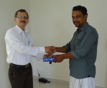 Our Site Engineer - Mansoor greeting Mr. Rajeendran of apartment F 11 in Crescent Tulip during handing over ceremony.