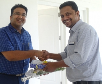 Our Site Engineer - Mansoor greeting Dr. Jishin Ahmed of apartment C 11 in Crescent Tulip during handing over ceremony.