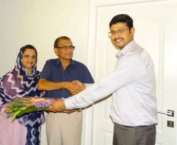 Our AGM Projects - Jeswint Clement greeting Mr. & Mrs. K V Basheer Ahamed of apartment C 2 in Crescent Tulip during handing over ceremony.