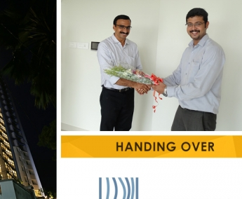 Our AGM Projects - Jeswint Clement greeting Mr. Vinod Kumar K. of apartment C 12 in Platinum Crescent during handing over ceremony.