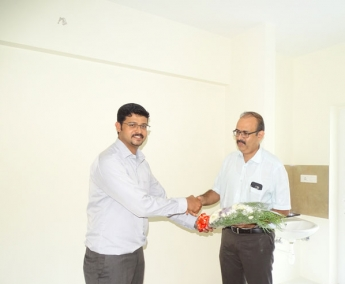 Our A G M Projects - Jeswint Clement greeting Mr. Paul Verghese of apartment no.B 4 in Crescent Zinnia during handing over ceremony.