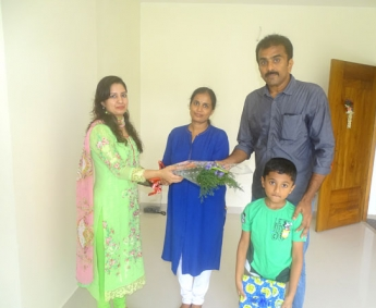 Our Asst.Manager Relationship & Marketing - Shilpa Madathil greeting Mr. Dinesh Kumar P.K of apartment no. A 4 in Crescent Zinnia during handing over ceremony.