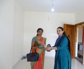 Our G M Sales & Marketing - Fathima Shafi greeting Ms. Aswathy.V.Nair of apartment no. A 3 in Crescent Zinnia during handing over ceremony.