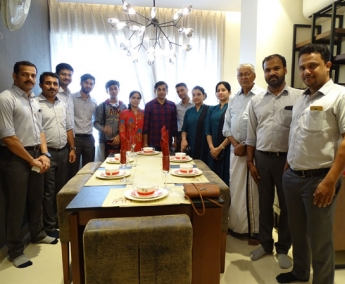 Our team with Mr.K. Vinod Kumar & Family of apartment no. A 1 in Crescent Zinnia after handing over.