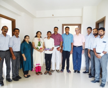 Our team with Mr.John K Joseph & family of apartment no.C 15 in Crescent Lavender, after handing over