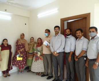 Our team with Ms.Rasheema Savad and family of apartment no. D03 in Crescent Lavender, after handing over