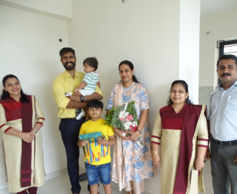 Our team with Mr.Bineesh P and family of apartment no. D08 in Crescent Lavender, after handing over