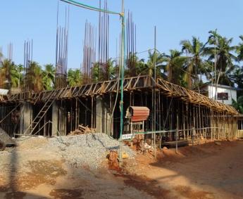 Shows ground floor column casting work in progress