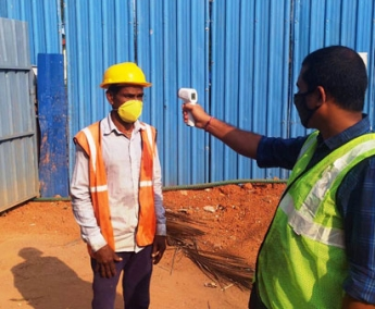 Shows medical check up being conducted for labours at site